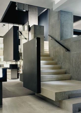 Studio Sofield. Concrete floors, stairs and walls. Panels.