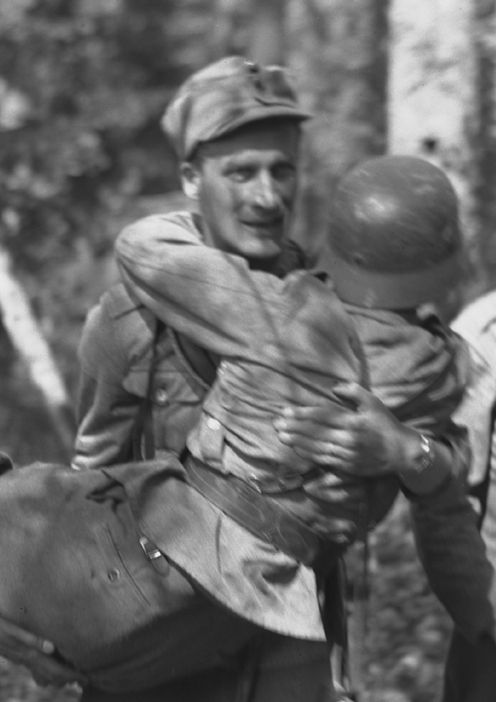 A Finnish soldier carrying his wounded comrade. Pin by Paolo Marzioli