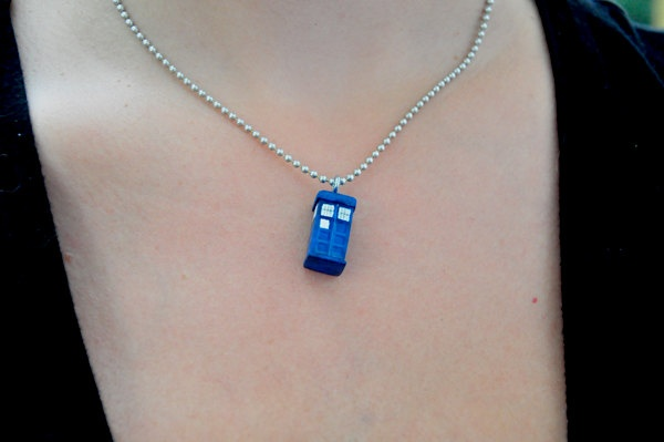 Tiny Tardis necklace. It's bigger on the inside.