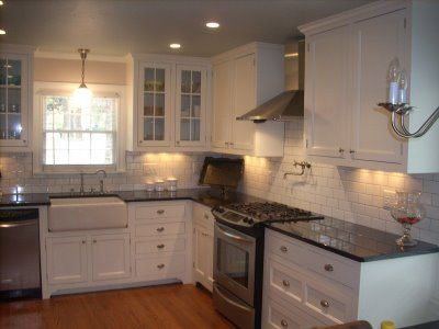 My 1929 kitchen remodel, white kitchen with an aqua ceiling and white subway tile. I love this kitchen...