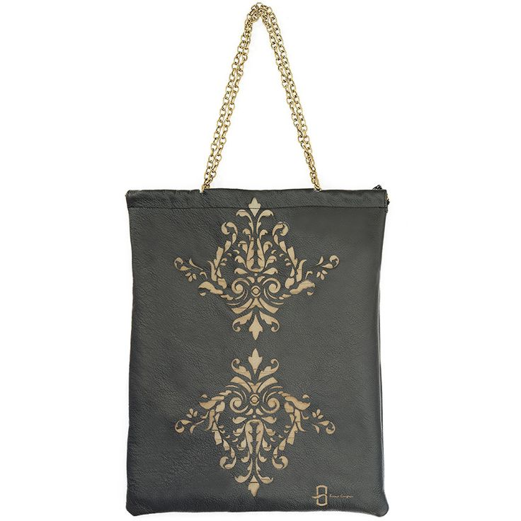Large shoulder bag inspired by Islamic art. Made from natural black leather…