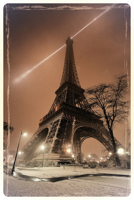 snowing at Eiffel Tower by Co1nCo1n, via Flickr