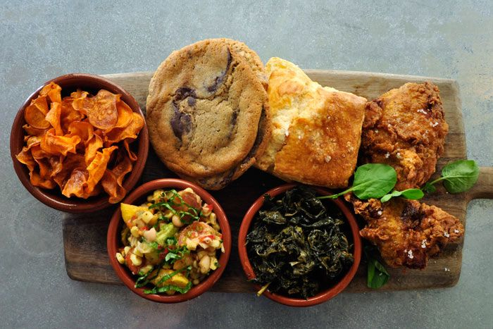 Fried chicken with buttermilk dressing, served with a house-made biscuit, long-cooked cavolo nero, summer succotash salad, and a chocolate chip or oatmeal cookie, by the Larder in Los Angeles