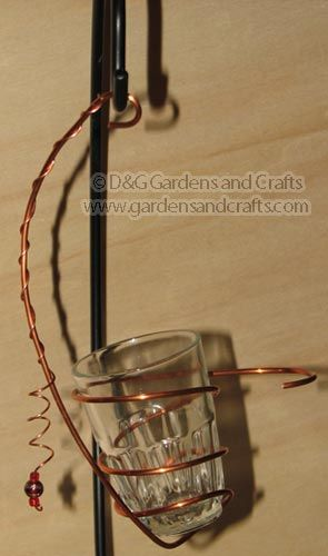 Hummingbird or Oriole Feeder using copper wire and a shot glass