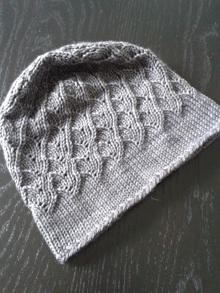 "hat for Lisa, pattern ""Milanese Lace Topper"" from Ravelry, Malabrigo Rios worsted ""Plomo"" (dark mauvy grey). 3.75 mm needle."