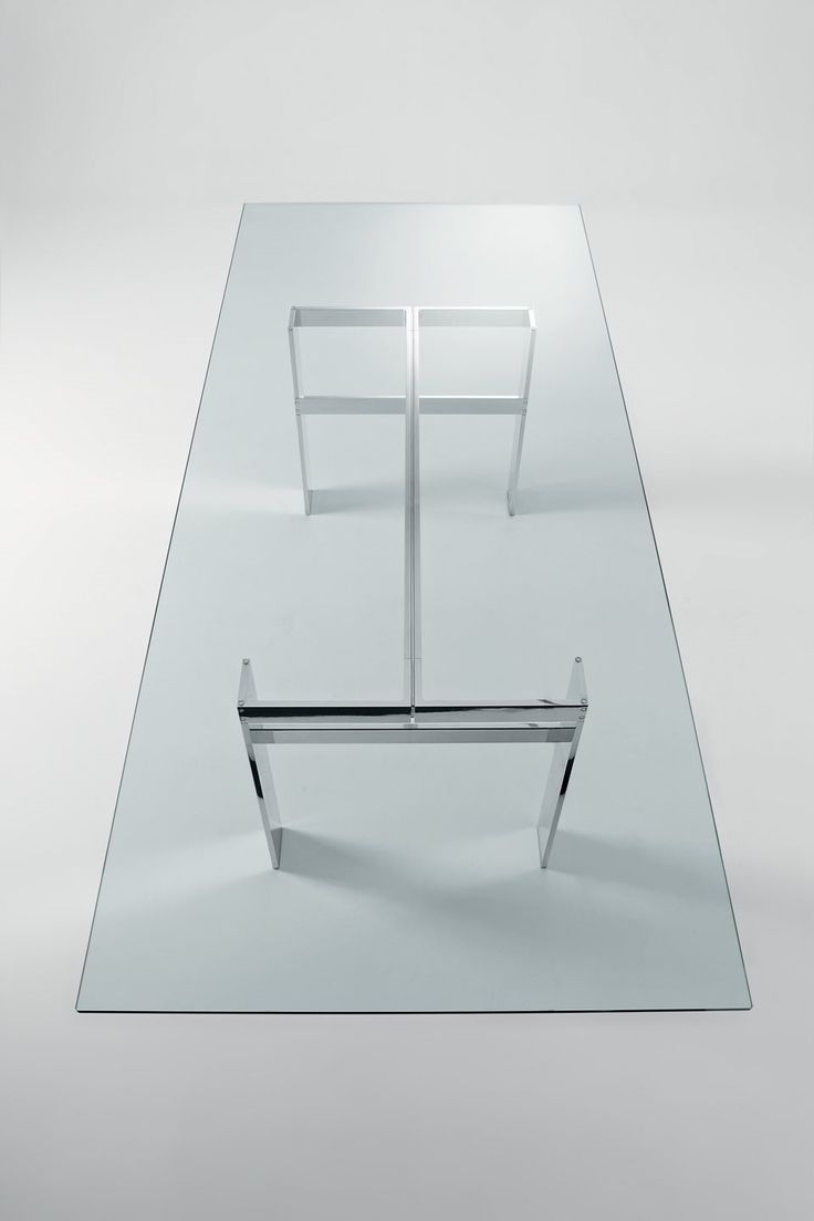 info: shop@coro.it  Still, Table in tempered transparent glass. Bright aluminium or hand-brushed aluminium in the colours black or titanium grey metal parts. Designed by Carlo Colombo for Gallotti&Radice.