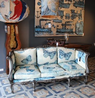 $18,600.00  Antique French walnut settee carved in the Louis XIV manner from the 1880s, with a silver gilt frame, and upholstered in David Bromley hand painted linen.A truly unique piece.