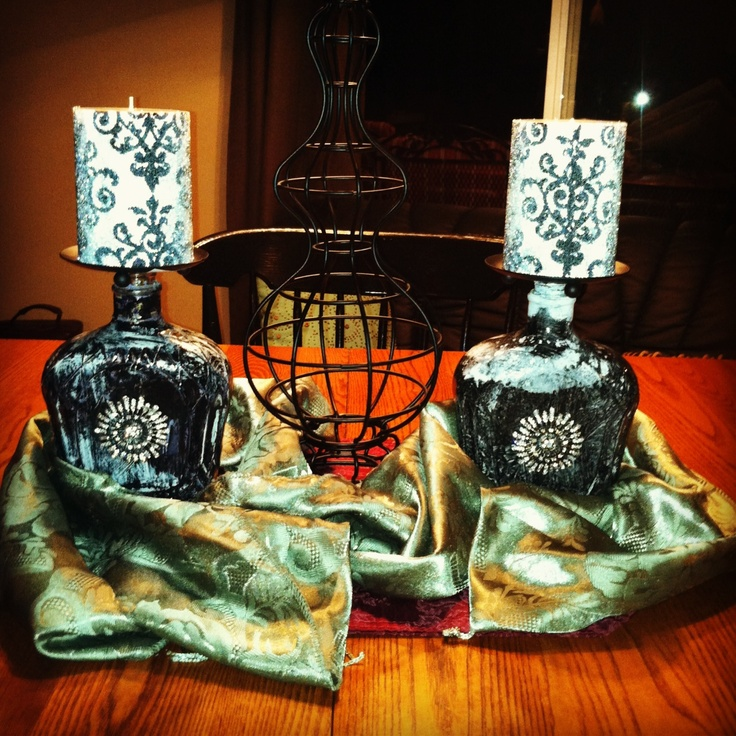 Hand painted Crown Royal bottles made into candle holders.