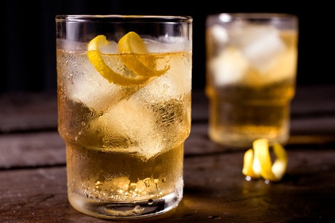 """Basic Highball - Was invented in 1895, but became common in the speakeasies in the 20's.  1 ounce whiskey  5 ounces cold ginger ale  Twist of lemon peel  Pour the whiskey into a chilled highball glass over ice. Add ginger ale to fill; then garnish with lemon peel. """"Build"""" the drink in the glass by slowly adding ingredients one at a time. Avoid overstirring freshly opened carbonated beverages."""