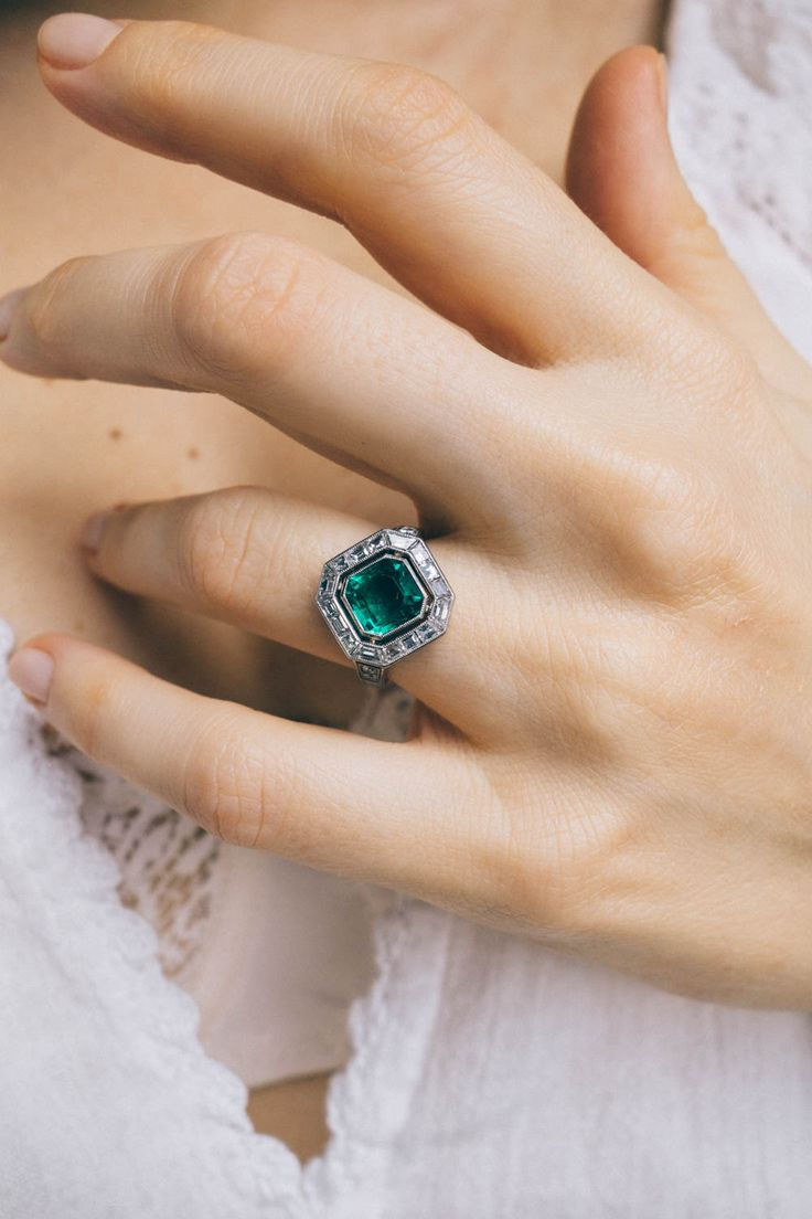 Art Deco vintage Cartier engagement ring centering upon an emerald-cut emerald weighing approximately 1.60 carats with AGL certificate stating the emerald is Colombian natural. Surrounded by 16 baguette and 4 single-cut diamonds. Set in platinum. Signed and numbered. Circa 1925