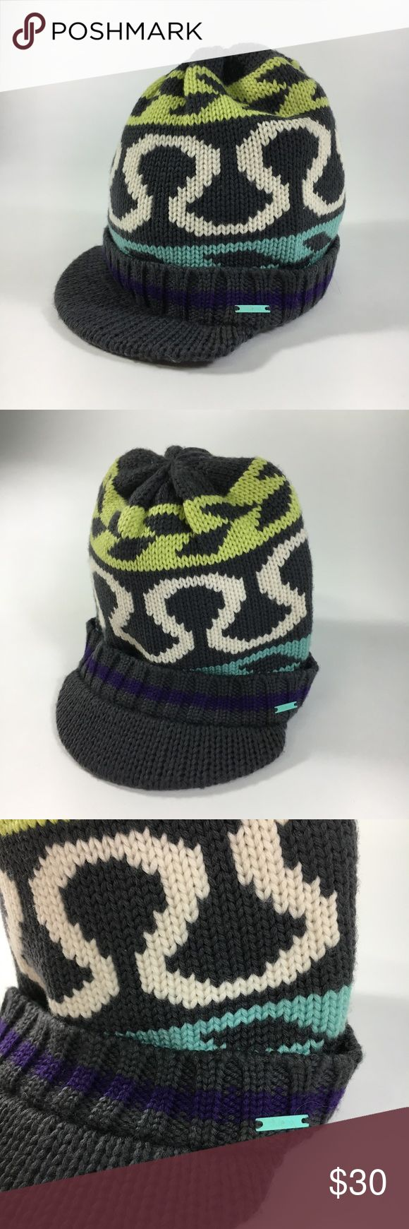Lululemon winter knit hat This hat is made of a thick knit and keeps your head warm. Has a very cute design on it as well as the lululemon symbol. Has a small flat brim in front, makes for a great snowboarding hat! Main color is grey with lime green, purple, light blue and white. Worn one 1 time and in great condition! lululemon athletica Accessories Hats