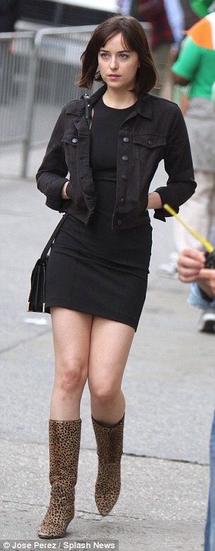 That's the spirit! Dakota Johnson cracks a smile while filming St. Patrick's Day Parade scene for How To Be Single in NYC
