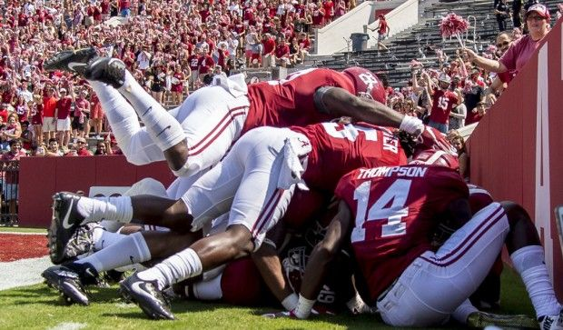 Alabama piles on Alabama running back Xavian Marks (19) after his touchdown on a punt return during the first half of Alabama's football game with Kent State, Saturday, Sept. 24, 2016, at Bryant-Denny Stadium in Tuscaloosa, Ala.  Vasha Hunt/vhunt@al.com