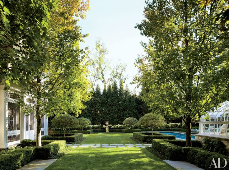 Boxwood hedges outline an Illinois home garden landscaped by Scott Byron & Co.