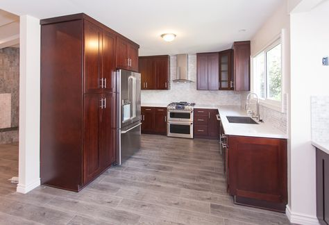 gray wood floors, warm cherry cabinets, white counters - contemporary kitchen