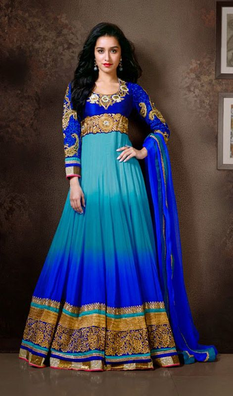 Blue Sharddha Kapoor Floor Length Anarkali Suit Win your spurs like Shraddha Kapoor in this ombre dyed sky and royal shade faux georgette floor length Anarkali suit. Kameez showcases contrasting yoke with pita work, resham and stick on crystals embellished foliage patterns on the neck, empire and hemlines Contrasting patch on the hemline compliments the look of the attire. #LatestAnarkaliSuitsOnline #BollywoodSuitsOnline