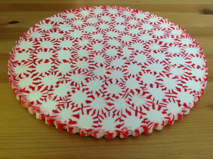 Taking the Starlight mint candy tray to a new level!  I used the edge of a round NON-STICK tart pan. Flipped upside down and filled with mints.  Baked on a pizza stone lined with parchment at 350 for about 20 minutes.  Let cool completely and pulled the tart pan off...  VOILA...a scalloped edge!