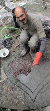 Jeffrey Bale, landscape artist & designer working on one of his pebble mosaics. via jeffreygardens