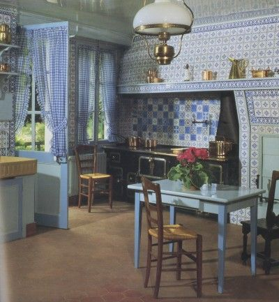 Monet's famous blue and white kitchen at Giverney. The walls are decorated with 19th century French tin glazed tiles.