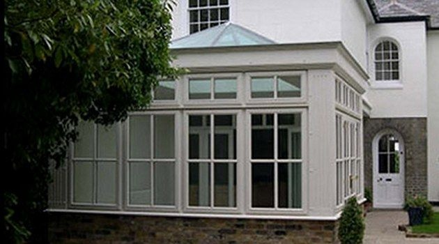 I like the smaller windows at the top - but perhaps with out the glazing bars…