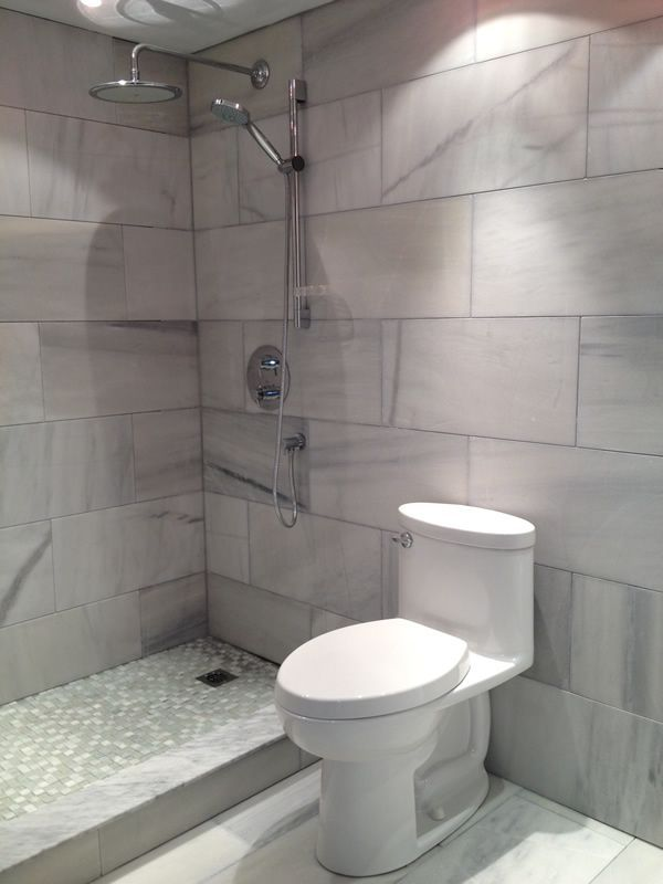 Use Large Format Tiles Through Out Your Entire Bathroom