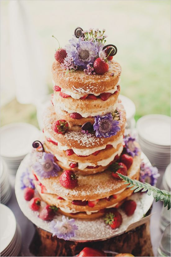 Naked cake with powdered sugar, berries, and flowers. Cake: Raindrop Desserts ---> http://www.weddingchicks.com/2014/05/10/bohemian-forest-themed-wedding-ideas/
