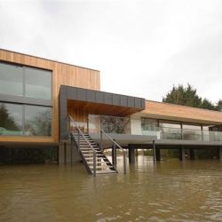 John Pardey Architects have built this contemporary home on stilts to withstand the season flooding.
