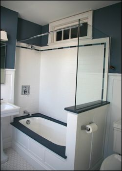 A glass half wall may be an idea for our bathroom reno. This is perfect! EXACTLY what I was looking for for the half wall in the bathroom