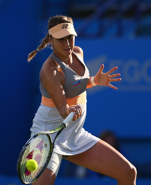 Belinda Bencic Photos - Belinda Bencic of Switzerland plays a forehand during her second round women's singles match against Elena Vesnina of Russia on day three of the WTA Aegon International at Devonshire Park on June 21, 2016 in Eastbourne, England. - Aegon International - Day Three