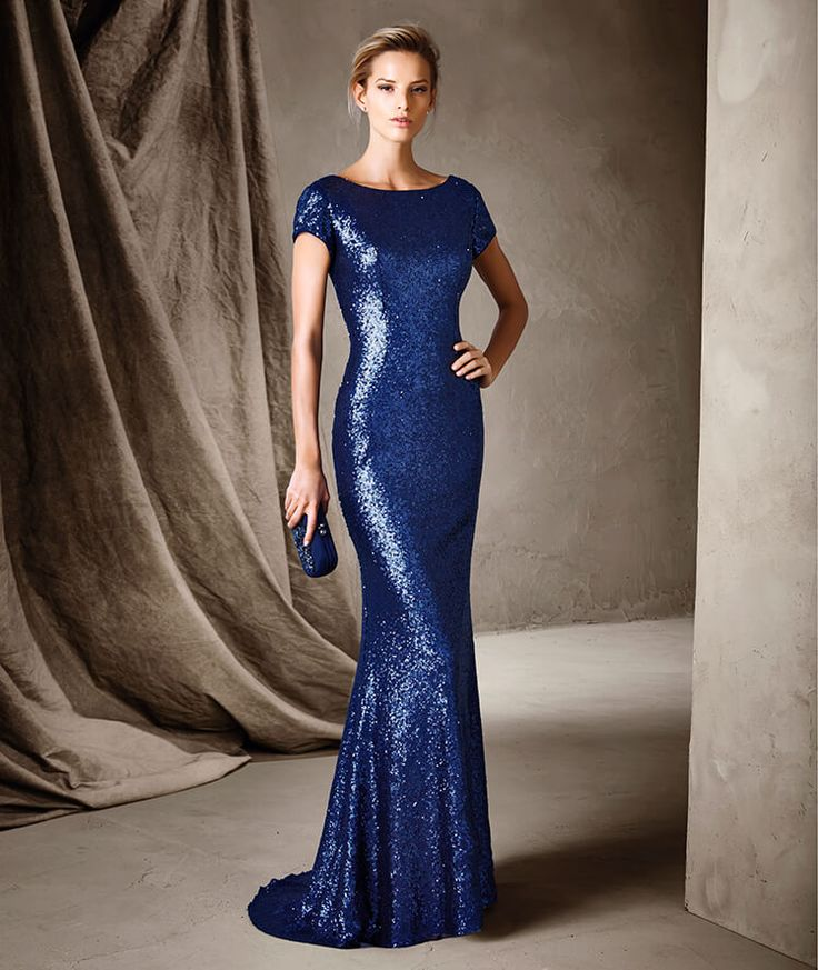 CINTRA. A stunning long party dress with a bateau neckline and mermaid silhouette that flatters the figure. A plunging V leaves the back bare. Gemstone embroidery draws attention to all your feminine charms. Simply spectacular.