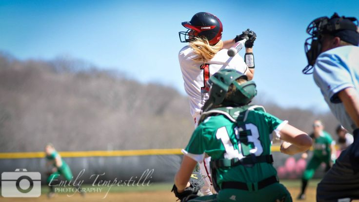 """""""It's long enough. It's high enough. It's..."""" by Emily Tempestilli, 2014, digital photograph using Nikon D9000. Subject matter: Taylor Blevins of Frostburg State University hits in game vs. York College (PA), April 2014. © Emily Tempestilli Photography. https://www.facebook.com/emilytempestilliphotography"""