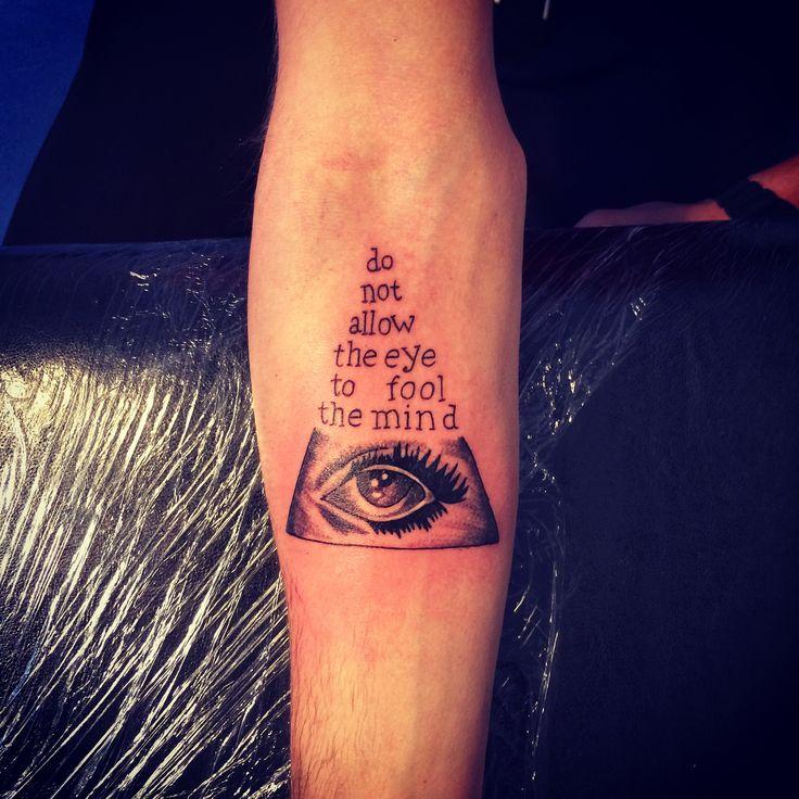 Triangle with eye tattoo illuminati