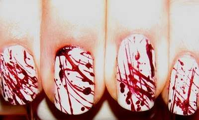 30 Hot Halloween Nail Looks... it looks like blood, I LOVE IT!!! Ok that was a little weird but oh whale: