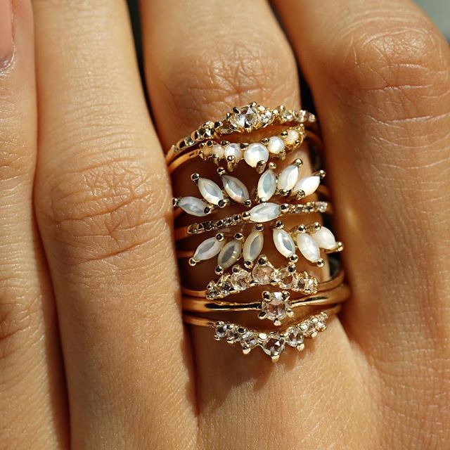 Sunbathing before the storm ✨all our new fine rings, stacked high into a tower of shining diamonds! Available now on laurieflemingjewellery.com #motherofpearl #finejewellery #bridal #engagementring #gemhuntrings #showmeyourrings #diamonds #alternativeengagementring #aesthetic #toronto #handmadejewelry #engaged