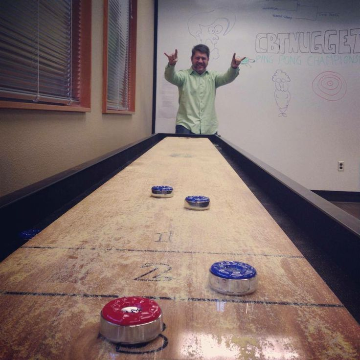Scott Morris Making Good Use Of Our New Shuffleboard Table During Our Most  Recent Trainerpalooza.