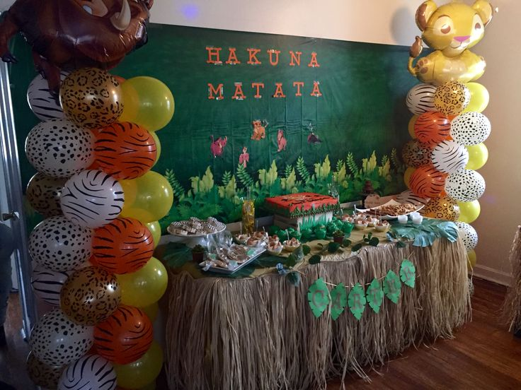 the lion kings first birthday party candy table idea