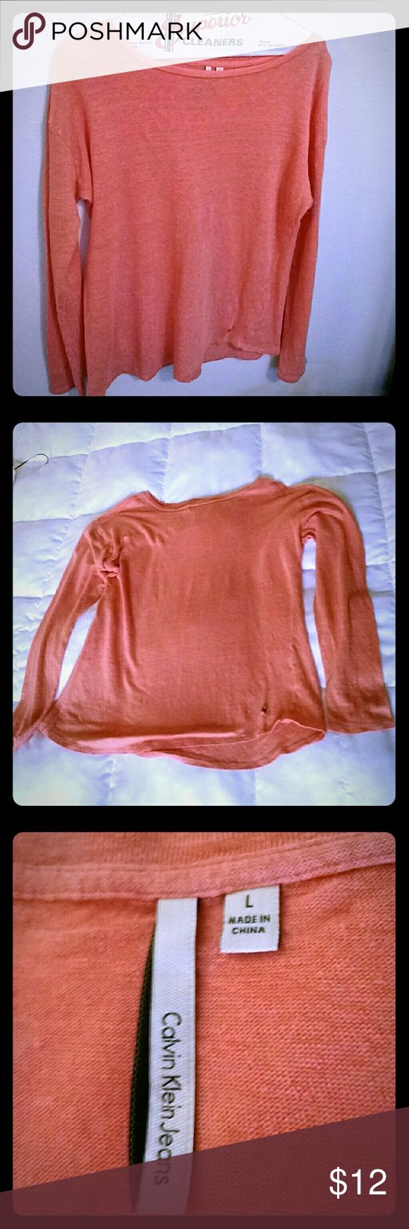 Calvin Klein Jeans Long Sleeve Linen Tee Shirt This shirt is pre-loved and well cared for, in great condition. Shirttail hemline?, light weight, semi sheer, boat neckline. Hangs 24 inches. Salmon (geranium) color. Tops