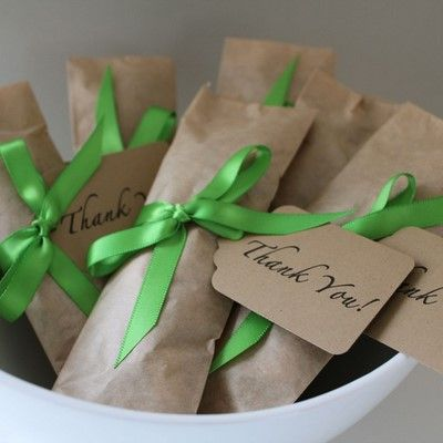 I'd like to leave a small gift for my guests on their plates with their place cards; preferably something that is recycleable or useable.  I like the idea of seeds of various types of native plants.