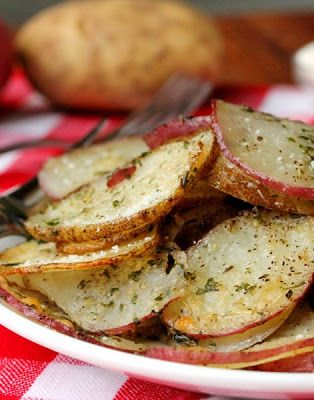 """Baked Herb and Parmesan Potato Slices - These baked herb and parmesan potato slices go great with any type of sandwich. The """"thinner"""" cut slices get crispy when they're baked and are soooo delicious right out of the oven! Perfect for a turkey sandwich the day after Thanksgiving."""