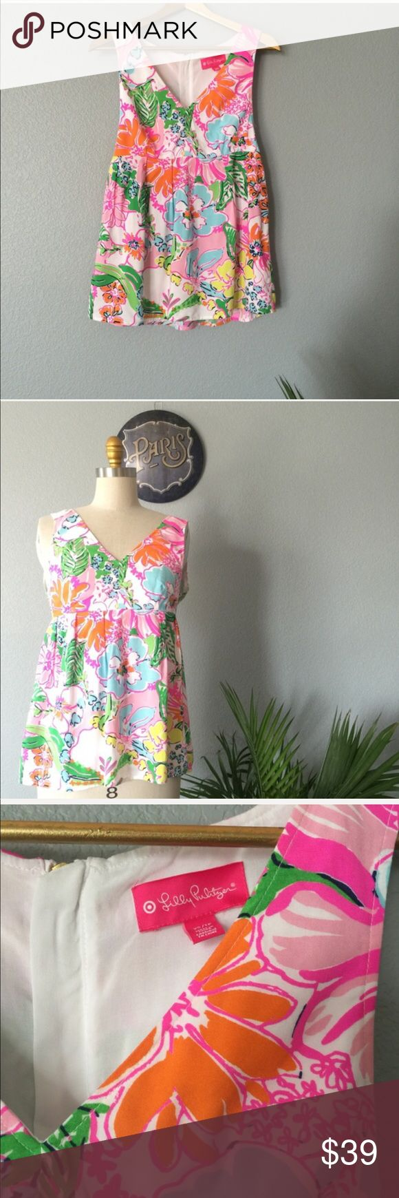 Lilly Pulitzer Peplum top size XS Lilly Pulitzer Baby Doll Top in the famous and so amazing pattern 💓 and so versatile. She'll and lining 100% Rayon. So perfect  NWOT ✅ will bundle 👌🏼✅🚭 ✅ all reasonable offers will be considered 👍🏼 🚫No Trading 🙅🏻 Poshmark rules only‼                        Ⓜwaist 26.5 Ⓜ️Bust 33.25 Ⓜ️ length from shoulder 28 Lilly Pulitzer for Target Tops Camisoles