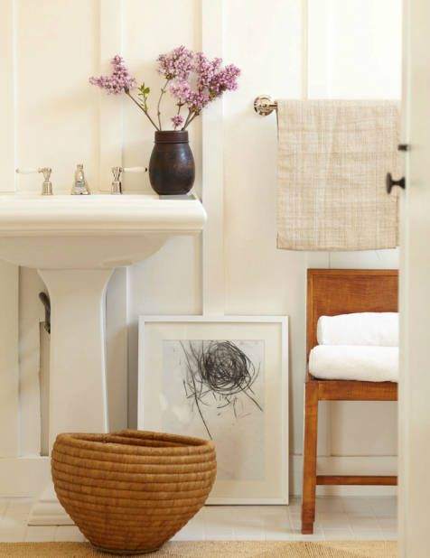 It's all about the details in a small neutral bathroom.  Styled by the incredible James Leland Day, this one's a winner!