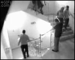 man stupidly climbs over rail and falls one floor