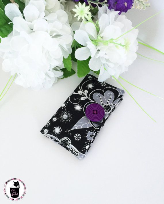 The purple button adds a bit of funk to this black and white flower inspired card holder