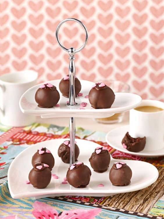 Cherry Ripe Truffles ~ {cake balls} Aussie candy bars blitzed in a food processor with sponge cake & cream cheese, shaped into balls, and coated in dark chocolate | recipe from Cadbury Kitchen Australia
