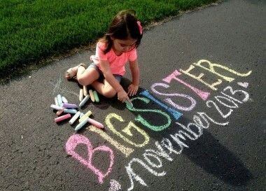 Sibling Pregnancy Announcement with Sidewalk Chalk