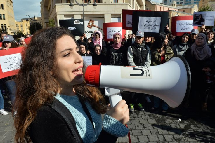 Activists from KAFA organization hold placards and shout slogans during a protest to denounce violence against women, in front of the Parliament in Beirut, Lebanon. (Wael Hamzeh / EPA) https://pow.photos/2018/lebanon-pow-25-31-january/