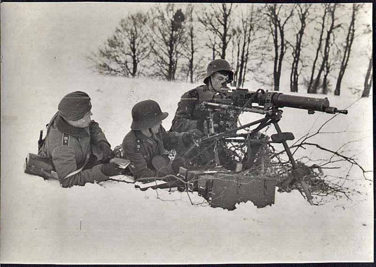 German machine gunners in the snow armed with most likely is a WW I MG 08  medium machine gun. Date and location unknown.