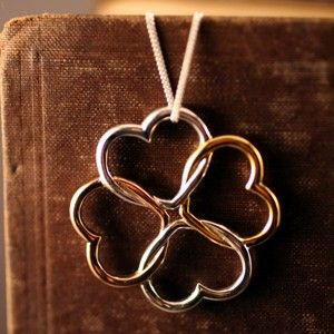Tri-color four leaf clover necklace    Two silver for Hope and Faith, yellow gold for luck and rose gold for love.