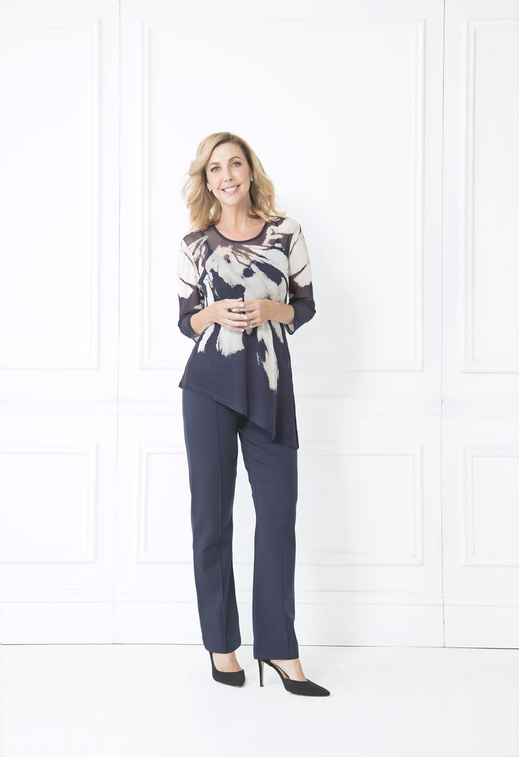 Make a statement with the Meriel Top. The flowing angled hem combines with the soft but eye-catching print to make for a great addition to your wardrobe. Pair with neutral navy pants and sandals to be brilliant in blue.  Seperate cami with mesh overlay/li> 3/4 length sleeve Round neckline