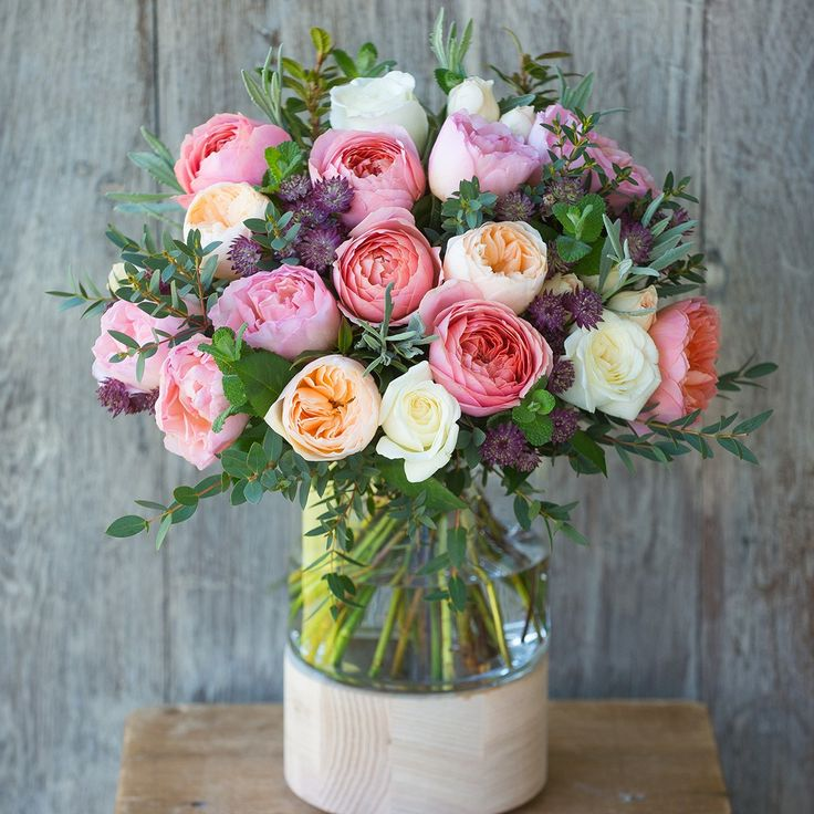 This limited edition bouquet has been designed to celebrate Her Majesty The Queen's 90th Birthday on Thursday 21st April. Filled with scented, Fairtrade garden roses and herbs, this elegant arrangement makes a wonderful gift.  We've handtied Princess Charlene, Vitality, Pavlova, Romantic Antike and David Austin's Juliet roses with mint and lavender to complement the rose's fantastic fragrance.  Please note the bouquet photographed is Large size. This bouquet comes in ...